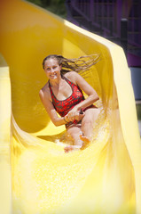 Woman Enjoying Ride down a Water Slide