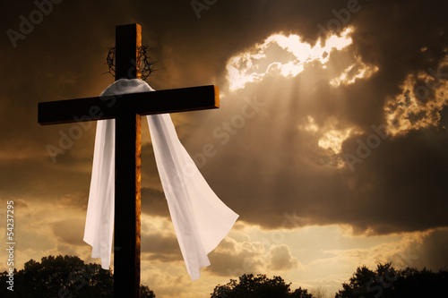 Dramatic Lighting on Easter Cross As Storm Clouds Break - 54237295