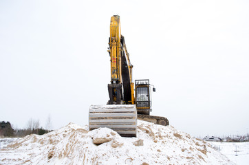 excavator pile sand pit soil snow winter industry