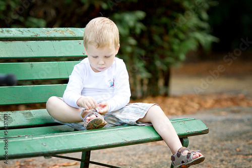 canvas print picture Three years old boy putting shoes