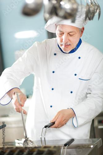 Mature chef  working in a restaurant kitchen