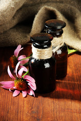 Medicine bottles with purple echinacea flowers