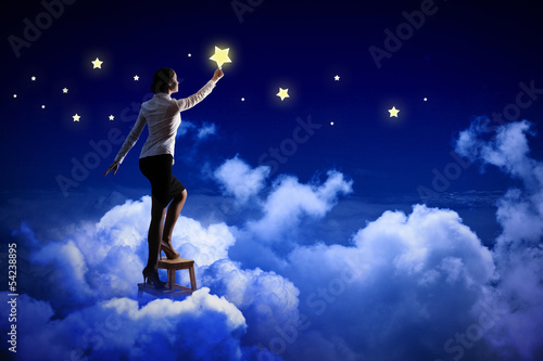 Woman lighting stars