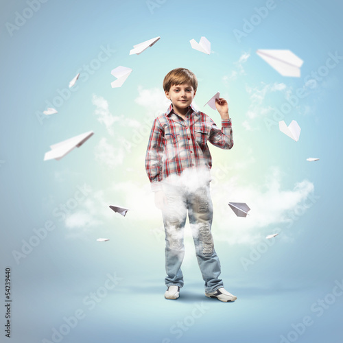 Little boy playing with paper plane