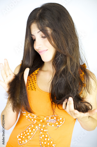 Happy woman looking at ironed hair satisfied