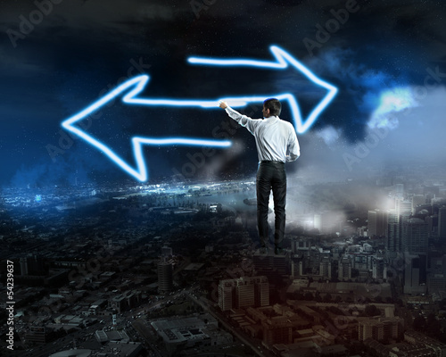 Businessman draws a glowing signs