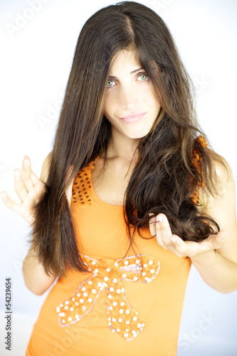 Woman showing half head with straight hair the other half wavy