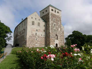 13th-century castle in Turku, Finland; roses in the foreground