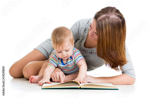 mother reading a book to baby boy