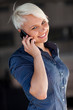 Businesswoman is phoning while smiling