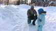 Child rolls the sled yourself to meet his father