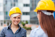 Smiling female constructors meet each other