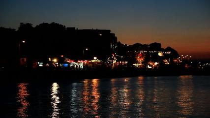 Amusement park near the sea at night