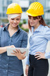 Female constructors are discussing their project