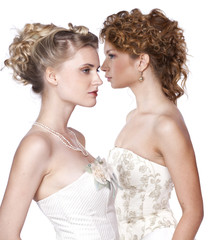 Beautiful two girls in the image of the bride