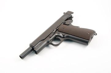 Empty hand gun against white background of the 1911 variety