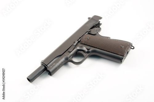Empty hand gun against white background of the 1911 variety
