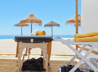 Massage area and a deck chair on the beach for therapy. Near the