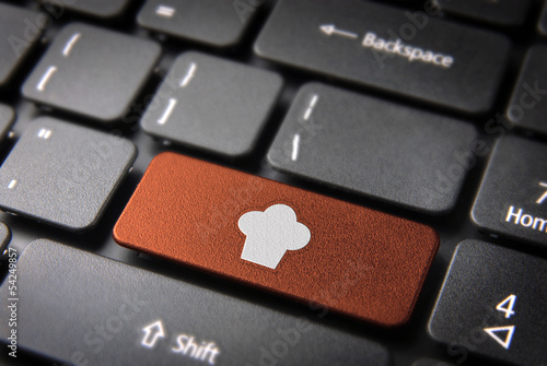 Orange Chef hat keyboard key, Food background
