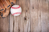 baseball and mitt on wooden background