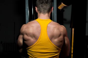 fitness trainer doing exercise for back