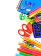Colorful border of school supplies over a white background