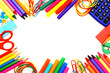 Colorful frame of school supplies over a white background