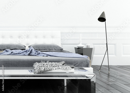 Luxurious white bedroom interior with double bed