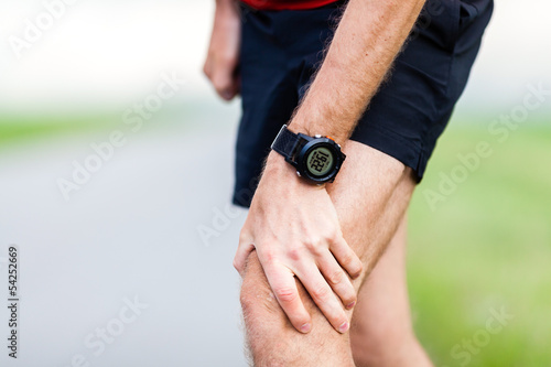 canvas print picture Running injury, knee pain
