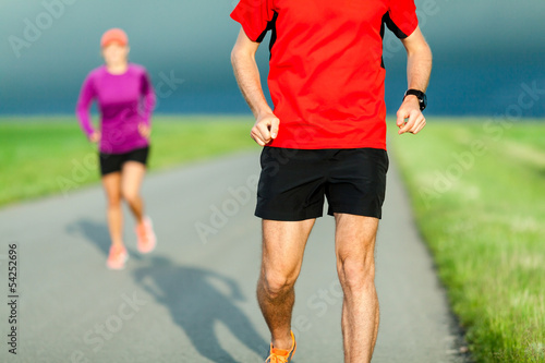 Couple running on country road