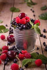 Assorted berries in pail