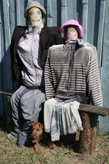 Two effigies near a shed
