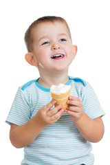 smiling kid boy eating ice cream in studio
