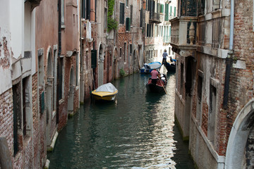 Narrow canal with gondolas in Venice, Italy