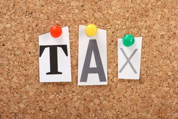 The word Tax on a cork notice board