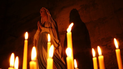 Holy statue of Mary with candles
