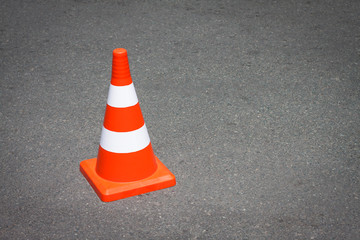 Traffic cone on asphalt surface.