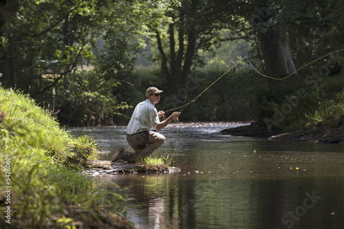 Tuinposter Vissen Fly fishing on an English river