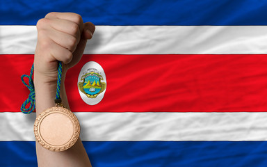 Bronze medal for sport and  national flag of costarica
