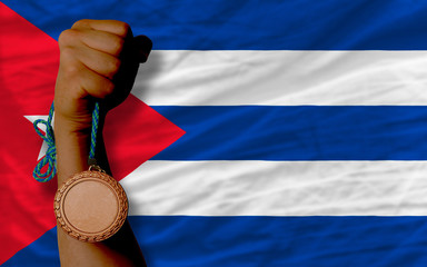 Bronze medal for sport and  national flag of cuba
