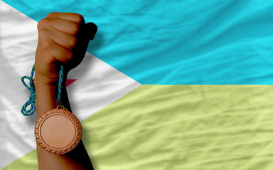 Bronze medal for sport and  national flag of  of djibuti