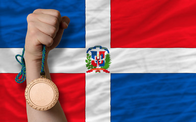 Bronze medal for sport and  national flag of dominican