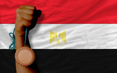 Bronze medal for sport and  national flag of egypt