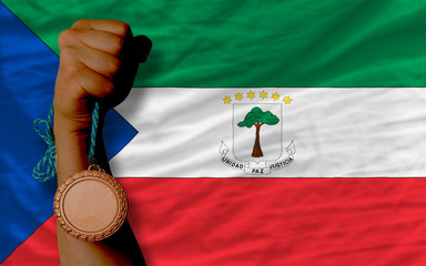 Bronze medal for sport and  national flag of  of equatorial guin