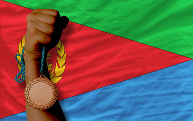 Bronze medal for sport and  national flag of  of eritrea