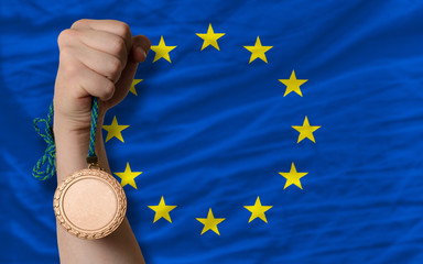 Bronze medal for sport and  national flag of europe