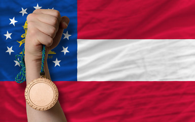 Bronze medal for sport and  flag of american state of georgia