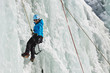 Female Ice Climber in South Tyrol, Italy