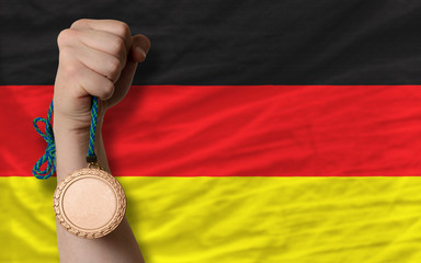 Bronze medal for sport and  national flag of germany