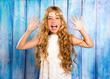 Hippie children girl excited open mouth with raised hands